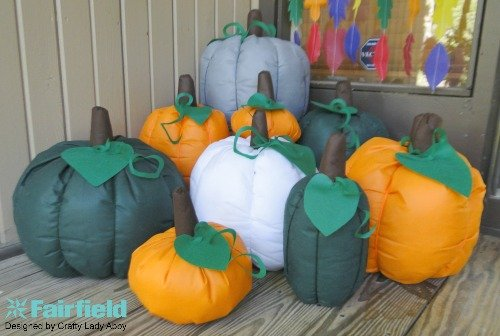 STUFFED PUMPKINS ON PORCH