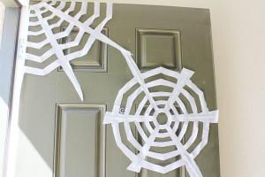 tape webs to door