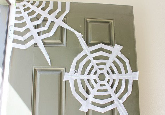 tape webs to door