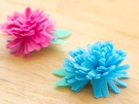 These super Easy Fabric Flowers are a cinch to make and can be customized into tons of colors!