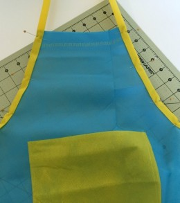 art apron pin on binding