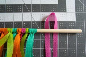Step 2 - loop Oly*Fun around dowel rod