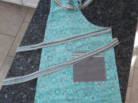 Apron with shield moisture barrier