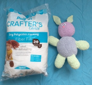 Bouncy Boucle Crochet Bunny, free pattern by Underground Crafter for Fairfield World | finished bunny with Poly-Fil Crafter's Choice